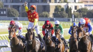 James McDonald stands high in the irons to applaud the win of Captivant at Randwick on Saturday. Picture: Jenny Evans/Getty Images