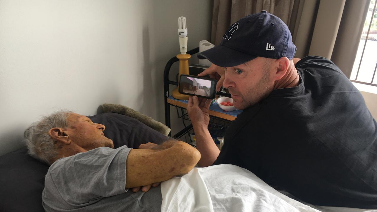 Rugby league legend Ben Kennedy tells a dying Ralph Jones he had bought a share in a racehorse for him. Pic: Supplied by Ben Kennedy.