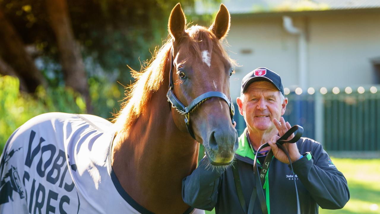 Trainer John Sadler and Starry Legend at their Caulfield stable. Photo: Jay Town
