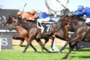 Think It Over (centre) edges out Dreamforce in the George Ryder Stakes.