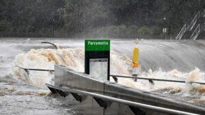 Flood water flows through the Parramatta wharf during the heavy rain on Saturday. Photo: Saeed KHAN/AFP.