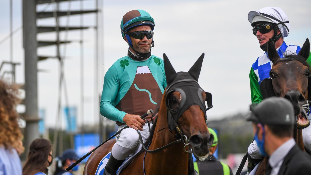 Irish Flame and jockey Michael Walker will be out to win the Mornington Cup for the recovering trainer Brett Scott. Picture: Racing Photos via Getty Images