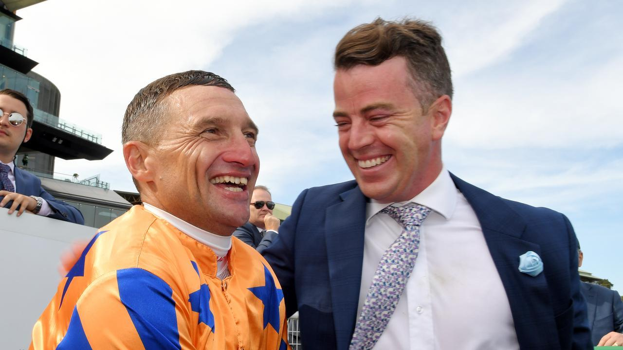 Jamie Richards with stable jockey Opie Bosson after Te Akau Shark won the 2020 Chipping Nortion Stakes at Randwick. Photo: AAP Image/Simon Bullard