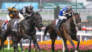 Mugatoo and Hugh Bowman get the inside run to take out the All-Star Mile ahead of Russian Camelot and Damien Oliver. Picture: Racing Photos via Getty Images