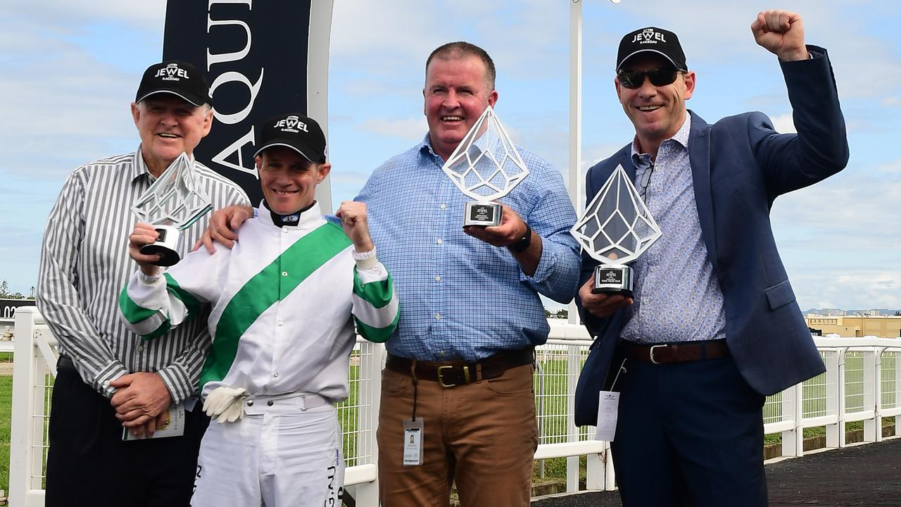 Kisukano owners Peter (left) and Robert (right) Reeves with jockey Mark Du Plessis and trainer Michael Nolan after the QTIS Jewel at the Gold Coast. Picture: Trackside Photography