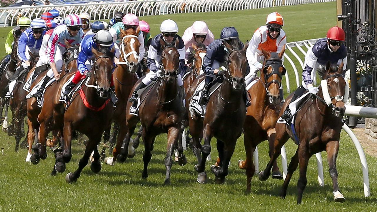 Jye McNeil aboard Twilight Payment leads the field out of the straight the first time in the Lexus Melbourne Cup on Tuesday. Photo: Darrian Traynor/Getty Images.