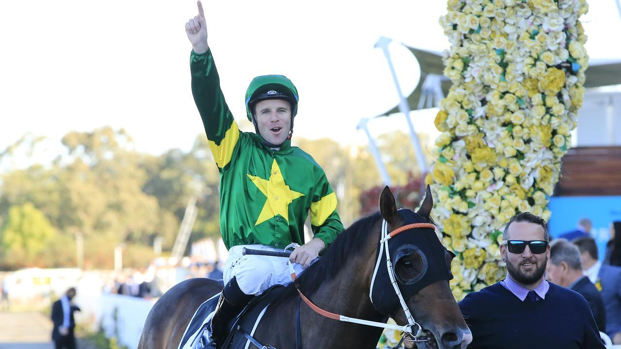 Tommy Berry and Ole Kirk return to scale after winning the Golden Rose.