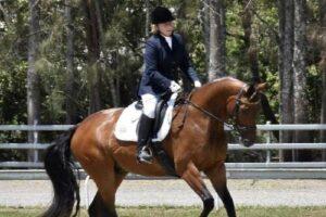 Taree trainer Coralie Burnett aboard one of he dressage horses.