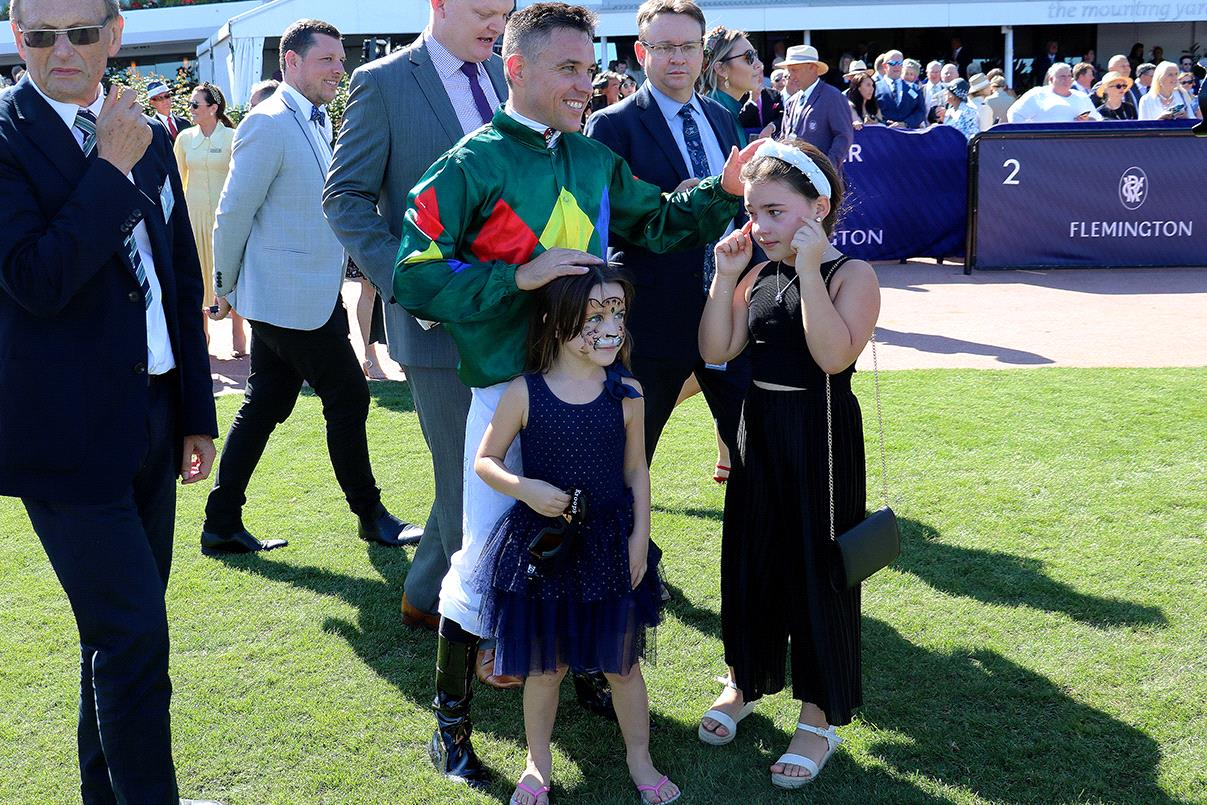 Ryan Maloney with his daughters after Alligator Blood's Australian Guineas win.