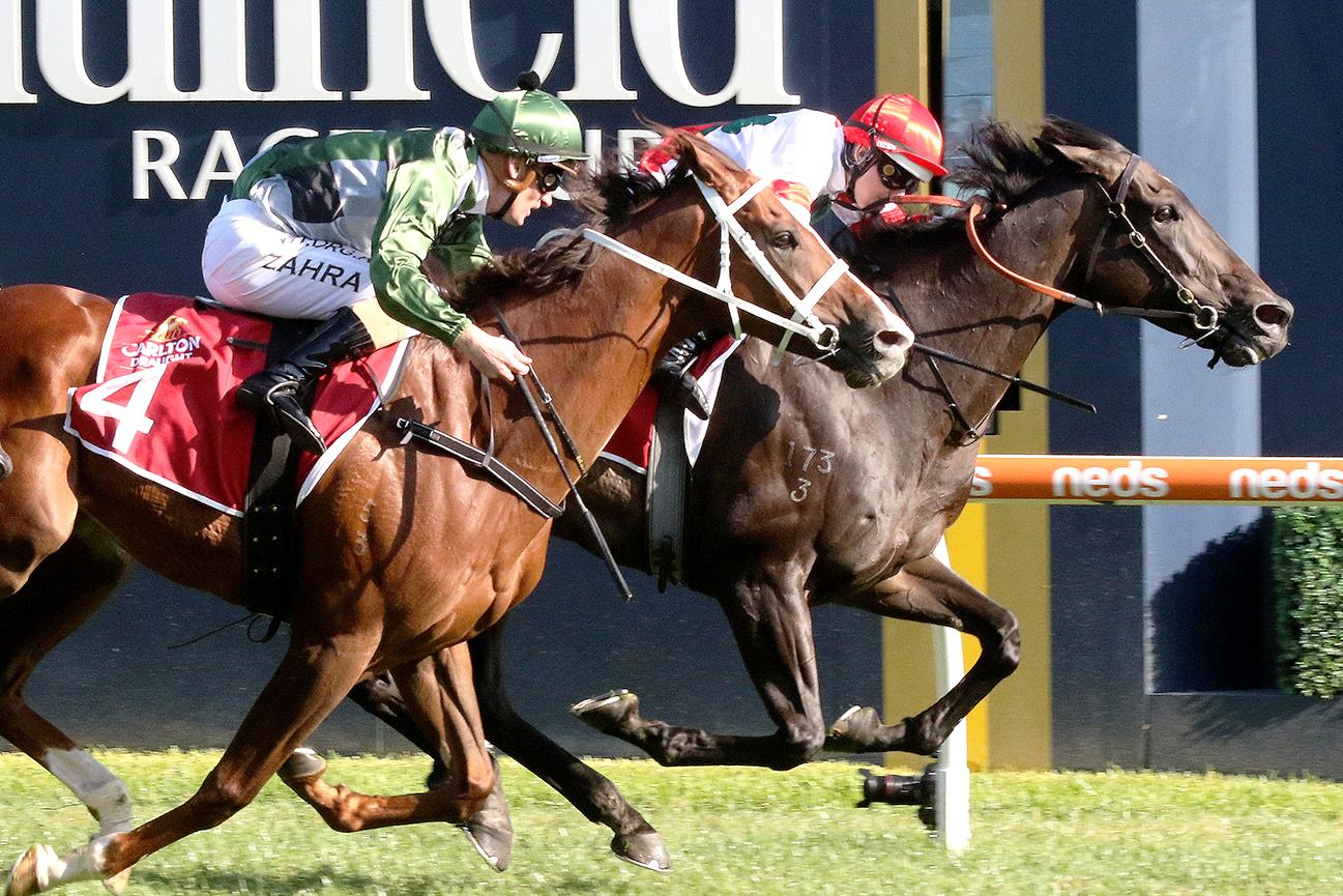 Miss Siska (red cap) held off King's Will Dream to win the Peter Young Stakes at Caulfield.