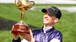 Jye McNeil with the 2020 Melbourne Cup trophy. Picture: Racing Photos via Getty Images
