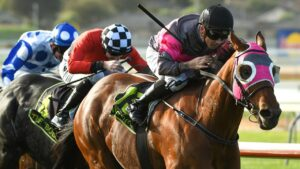 Inn Keeper and jockey Dean Holland surge to victory in the Wangoom Handicap at Warrnambool. Picture: Getty Images