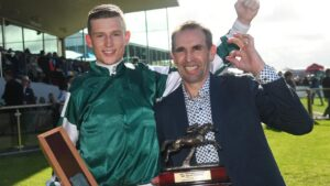 Brett Scott (right) celebrates with jockey Will Gordon after The Statesman's win in the Galleywood Hurdle at Warrnambool. Picture: Getty Images