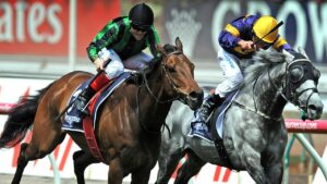Craig Williams rides Alcopop (left) overtakes Glass Harmonium to win the 2012 Mackinnon Stakes. Picture: AAP