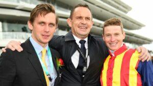 Charlie Duckworth with trainer Chris Waller and jockey James McDonald. Picture: AAP