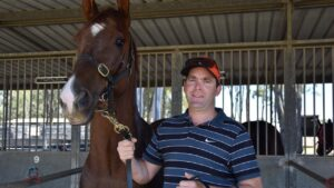 Glenn Richardson, pictured with Man of Law after winning the Nanango Race Club trainer of the year. Photo: Supplied