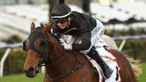 Jamie Kah moved to 99 wins after booting home Token Spirit in Mahogany Challenge Final at Flemington. Picture: Getty Images