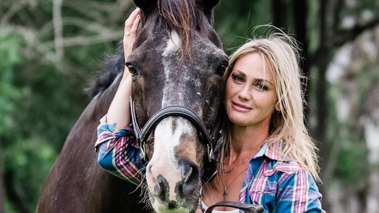 Laura Cheshire with horse Cadillac in a Save A Horse Australia calendar. Picture: Supplied
