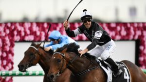 Jockey Ben Looker celebrates after riding Victorem to victory at Eagle Farm. Picture: AAP Image–Albert Perez