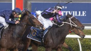 Media Award and Luke Nolen hold off the challengers to prevail in the Australasian Oaks. Picture: Atkins Photography