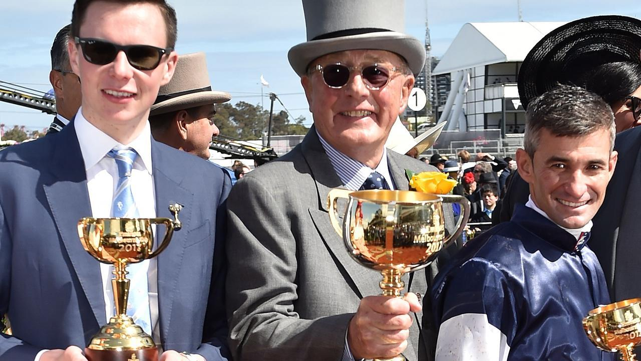 Lloyd Williams (centre) celebrates with trainer Joseph O'Brien and jockey Corey Brown after winning the 2017 Melbourne Cup with Rekindling. Picture: AFP