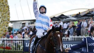 Tommy Berry looks to the heavens after winning the Golden Slipper with Stay Inside. Picture: Getty Images