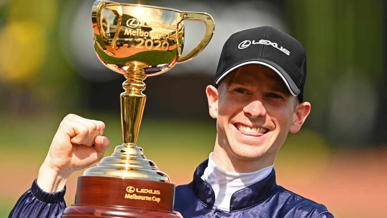 Jye McNeil with the Melbourne Cup after winning aboard Twilight Payment last year. Picture: Getty Images for the VRC