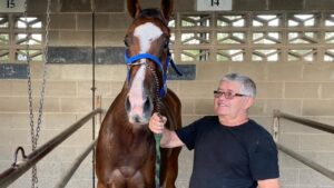 Trainer Kevin Hansen and Sweet Dolly. Picture: Tony McMahon
