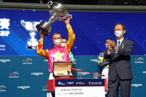 Zac Purton celebrates winning his second LONGINES International Jockeys' Championship.