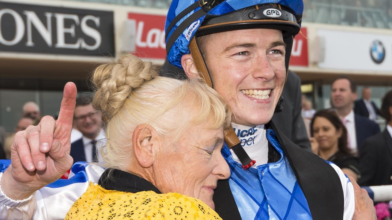 Cranbourne trainer Udyta Clarke with jockey Patrick Moloney after one of Rich Charm's wins at Caulfield. Picture: Getty Images
