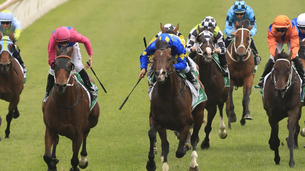Jay Ford and Archedemus (cerise) combine to win The Gong. Picture: Getty Images