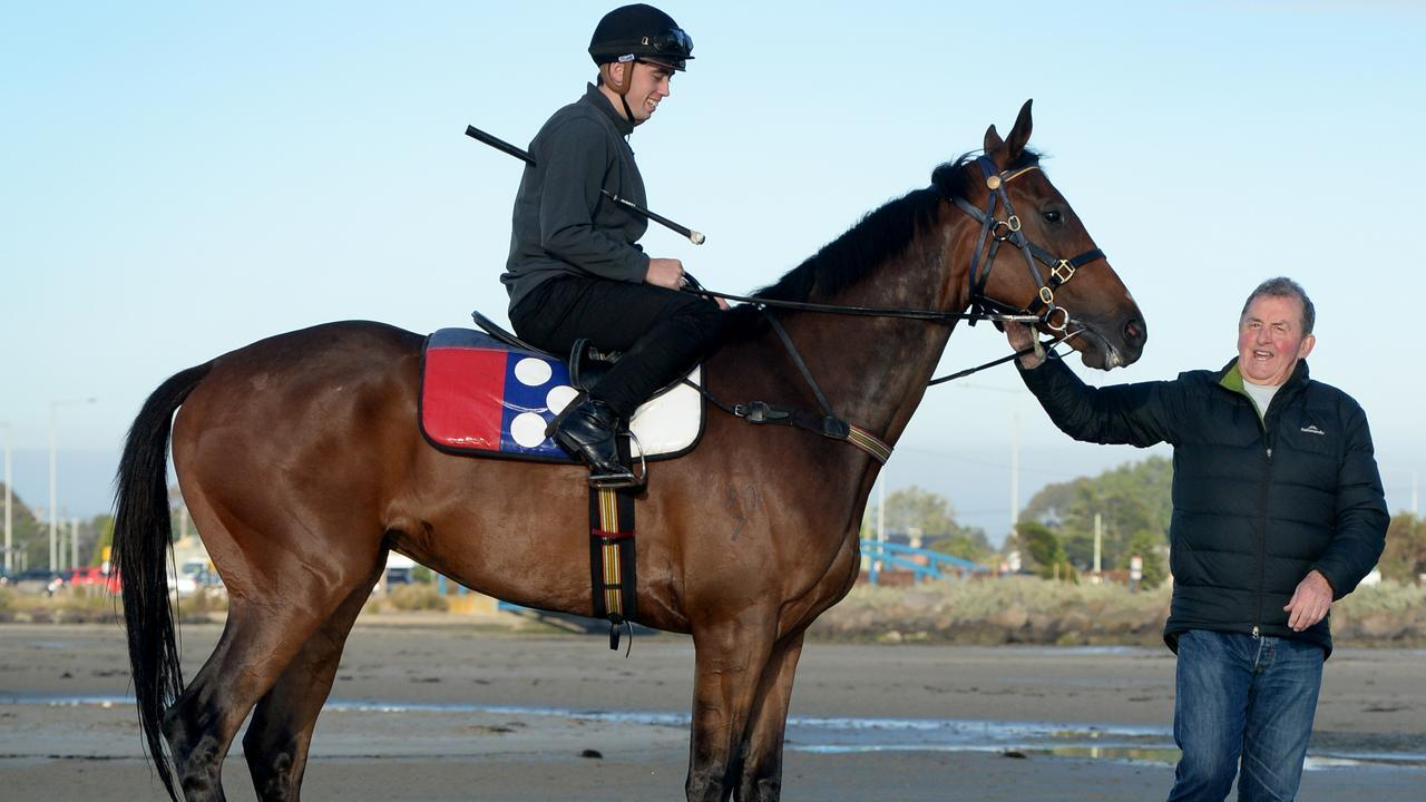 Denis Pagan with Victoria Derby hope Johnny Get Angry and jockey Lachlan King at Altona Beach. Picture: Andrew Henshaw