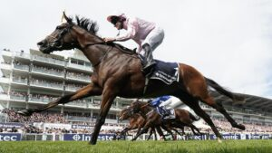 Caulfield Cup topweight Anthony Van Dyck in action winning last year's English Derby at the Epsom Downs track. Picture: Alan Crowhurst/Getty Images