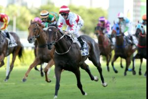 Zac Purton steered Awe to victory for trainer John Moore at Sha Tin on Sunday.
