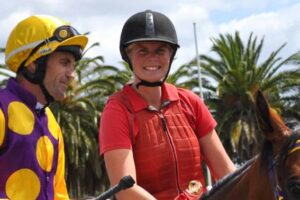 Sarah Cotton (right) in her guise as the clerk of the course. She'll saddle Dark Wanderer at Launceston on Sunday.