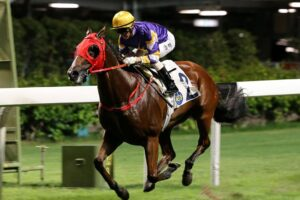Zac Purton steered Golden Dash to victory at Happy Valley in Hong Kong.