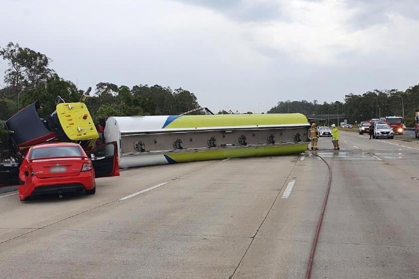 Police have declared an emergency situation following a fuel tanker rollover on the M1 at Helensvale.