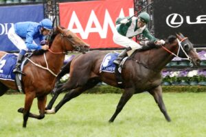 Exceedance surges past Bivouac in the Coolmore Stud Stakes.