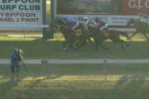 Victory Toast (inside) and Great Fox (outside) cross the line at Yeppoon in July.