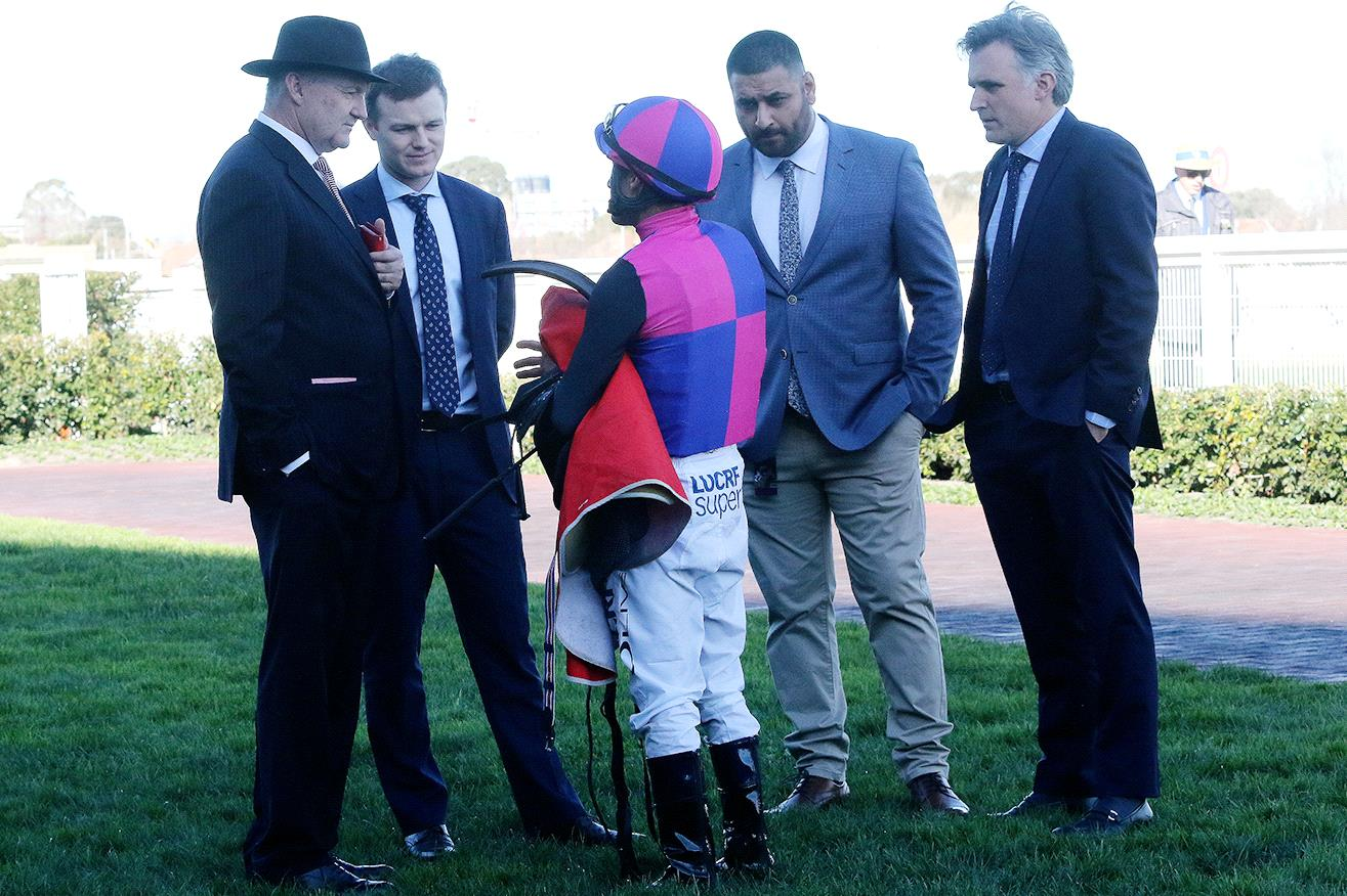 The Hayes camp and Damien Oliver discuss Vega Magic's flop.