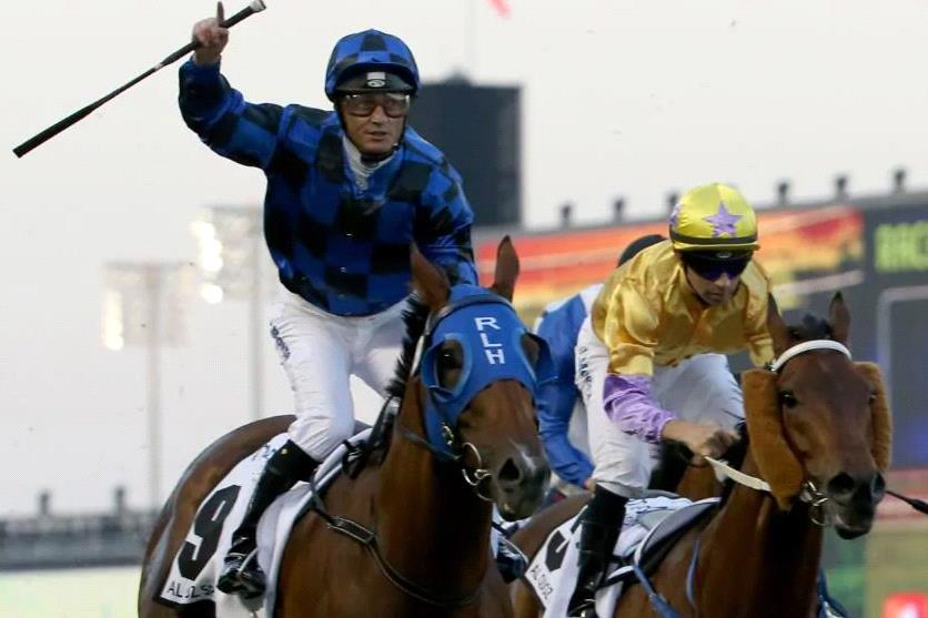 Damian Browne salutes after Buffering wins the Al Quoz Sprint in Dubai in 2016.