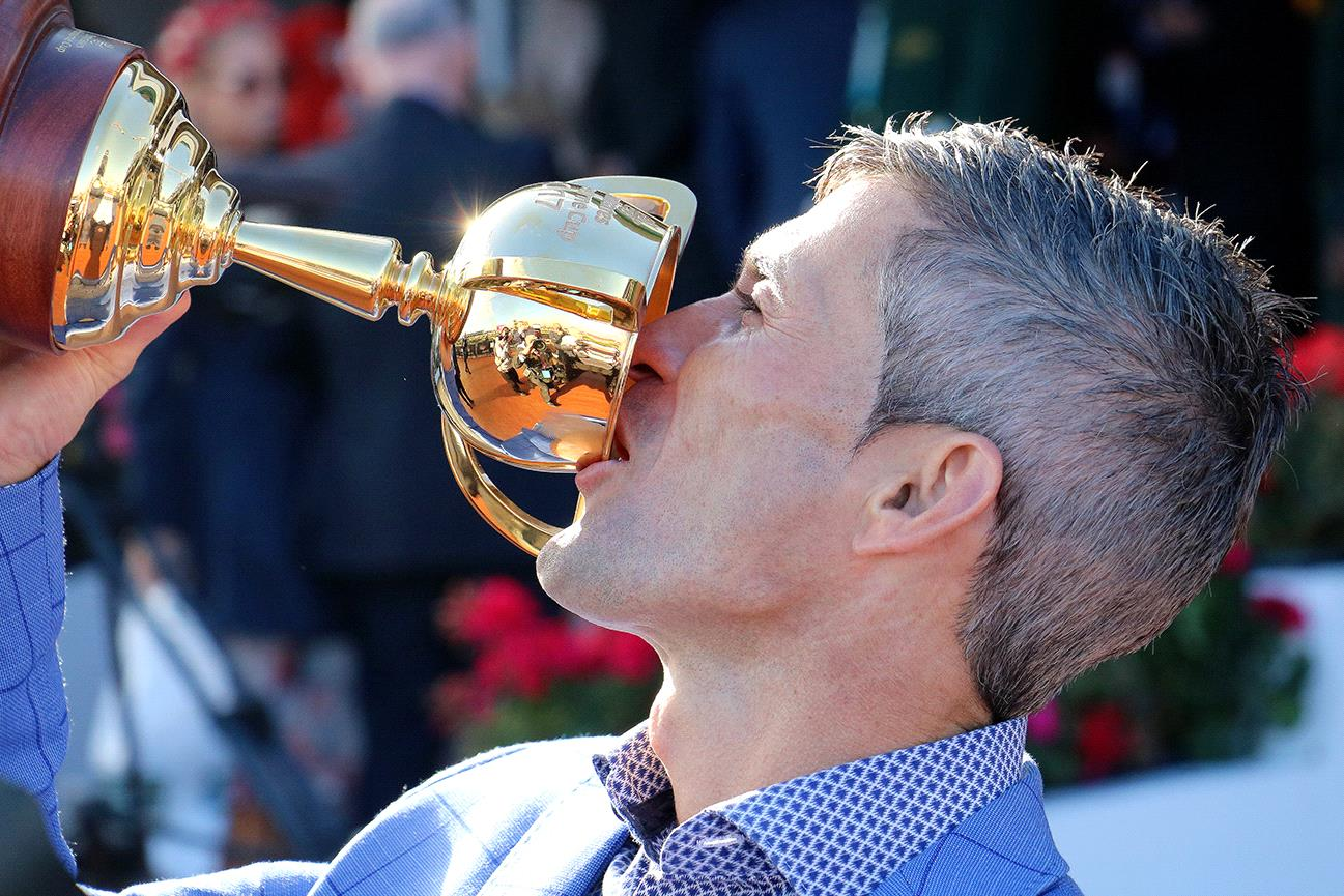 Corey brown celebrates last year after winning the Melbourne Cup aboard Rekindling.