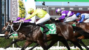 Subterranean (yellow) gets his nose in front of Ranch Hand on the winning post in the Ken Russell Memorial Classic at Gold Coast. Picture: Grant Peters/Trackside Photography