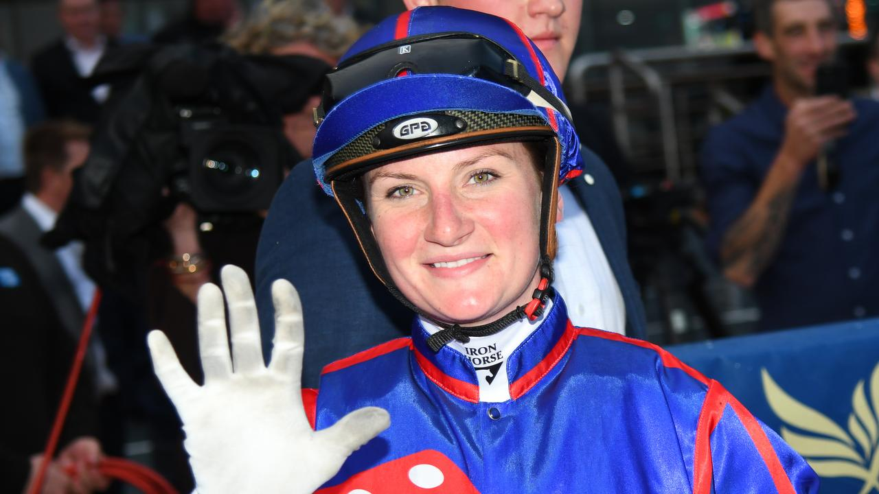 Jamie Kah gives a high five after a day out at Caulfield. Picture: Vince Caligiuri/Getty Images