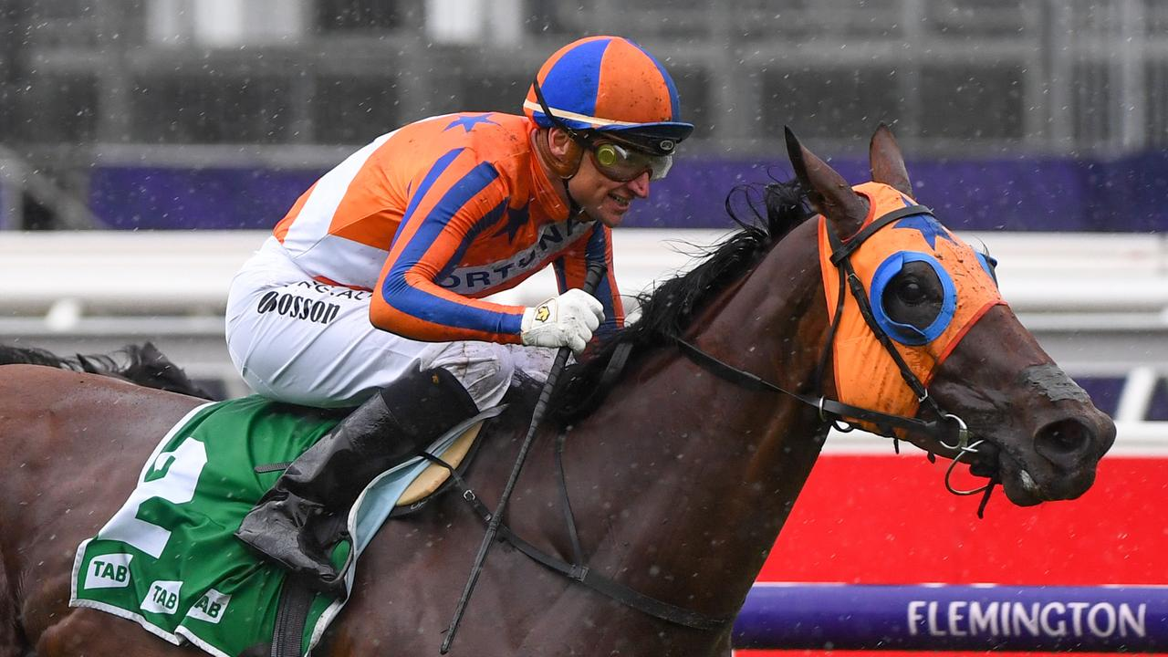 Opie Bosson on Melody Belle winning the TAB Empire Rose Stakes at Flemington. Photo: AAP Image/Vince Caligiuri