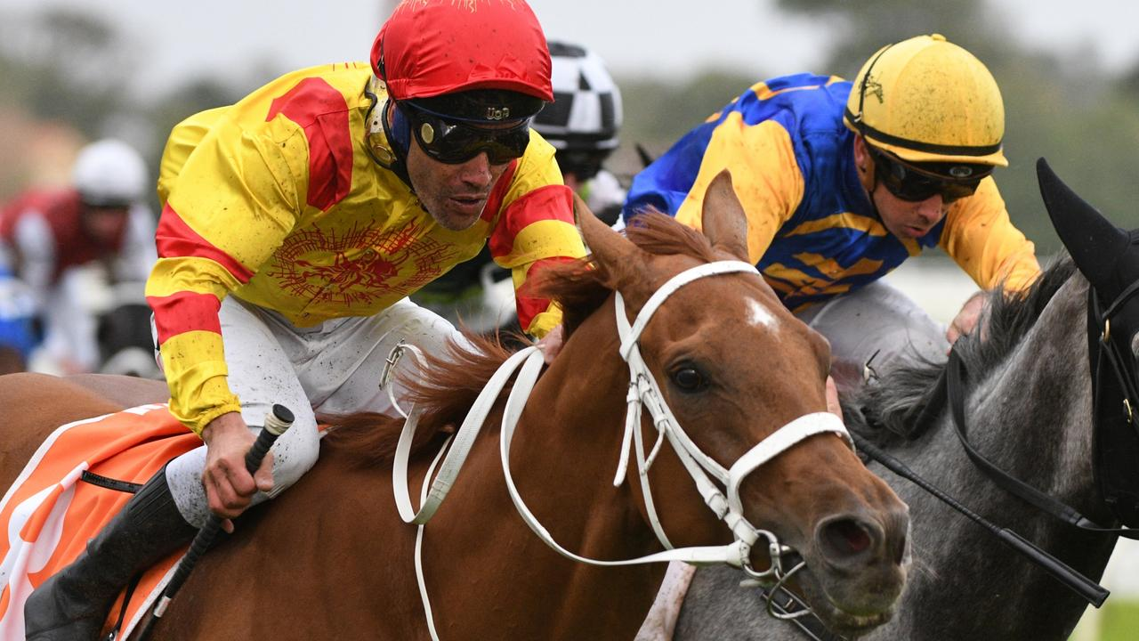 Injured jockey Michael Walker had seven rides at Flemington, including Mohican Heights in The Andrew Ramsden. Picture: Vince Caligiuri/Getty Images
