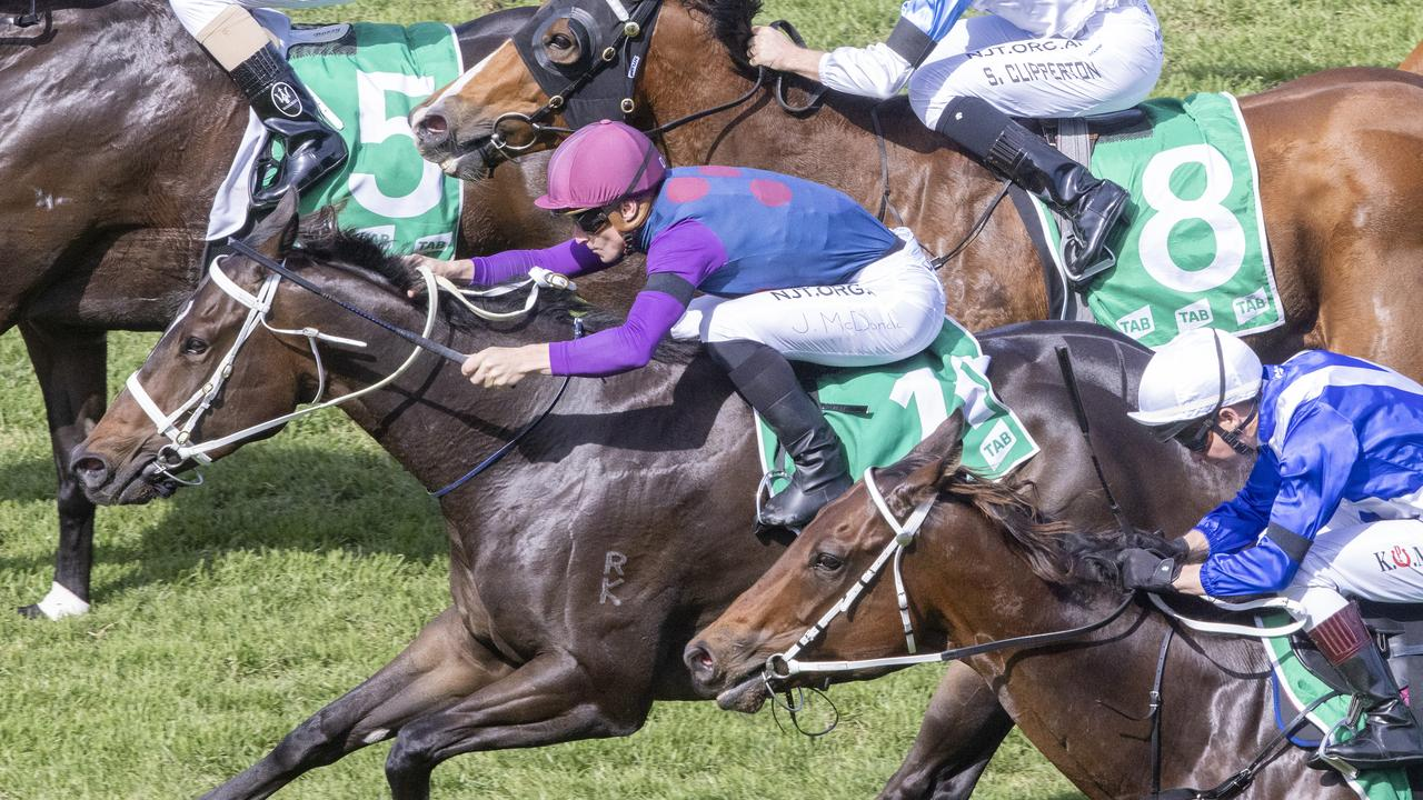 Ahead Start, ridden by James McDonald (pink cap), wins the Highway race at Randwick. Picture: Getty Images