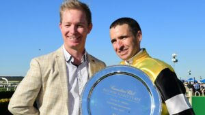 Trainer Will Hulbert and jockey Michael Rodd after Criminal Defence won the Rough Habit Plate at Doomben. Picture: Grant Peters/Trackside Photograpy