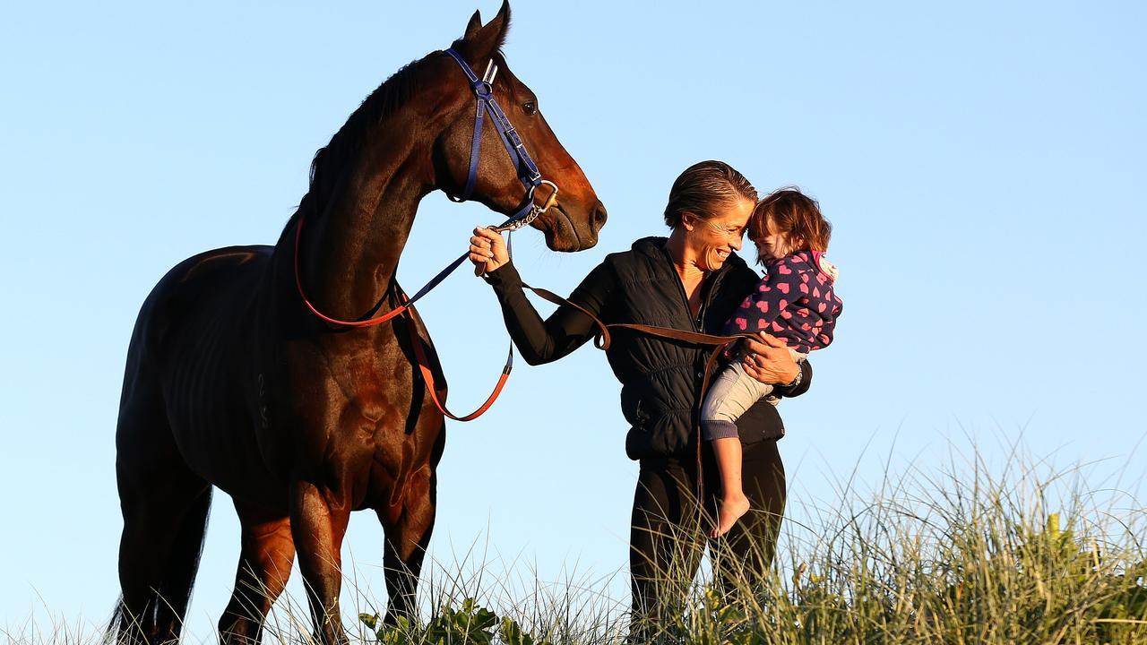 Kristen Buchanan with then two-year-old daughter MacKenzie and Sapphire Stakes winner Two Blue in 2016. Picture: Adam Head