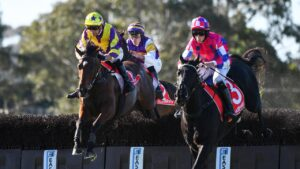 Clayton Douglas on Riding High (L) gets past Rexmont in the Australian Steeplechase at Sandown Lakeside. Photo: Vince Caligiuri/Getty Images